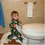 child with toilet paper
