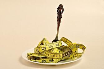 Dinner fork in measuring tape