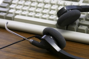 call center headphones on keyboard, featured on MarketResearch.com www.blog.marketresearch.com