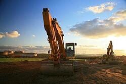 Bulldozer_in_Field, featured on MarketResearch.com