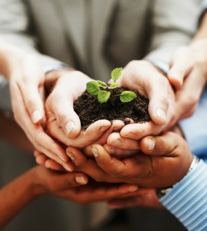 hands_holding_soil_and_plant_growing, featured on www.blog.marketresearch.com