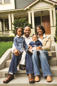 African american family sitting on step