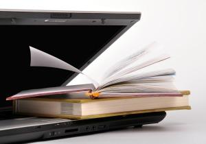BooksOnLaptop_Featured on www.blog.marketresearch.com